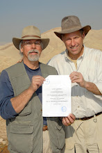 Photo: Dr. Steve Collins and Field Archaeologist Gary Byers hold the Trinity Southwest University agreement with the Kingdom of Jordan Dept. of Antiquities