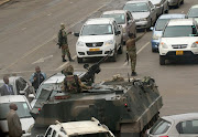 Military vehicles and soldiers patrol the streets in Harare, Zimbabwe, on November 15, 2017.