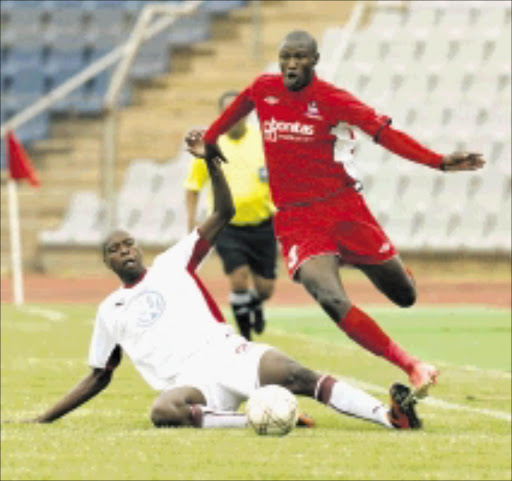 20091223AMU/SPORTS/SOCCER. Free State Stars Ayanda  Gcaba drebble past Moroka Swallows Lungisani Ndlela during their ABSA/.PSL match at Dobsonville Stadium in Soweto. PHOTO: ANTONIO MUCHAVE