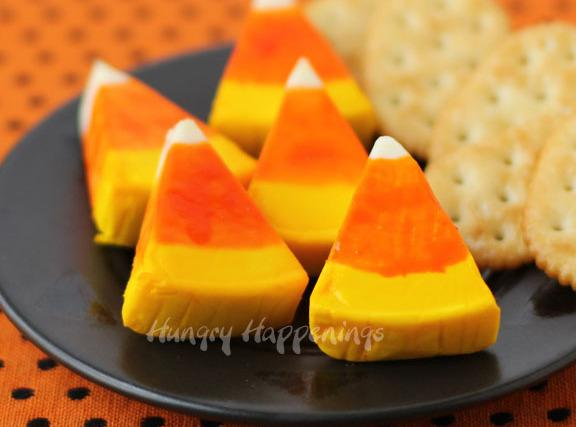 Dip never used paint brush into orange or yellow food coloring to paint wedge...
