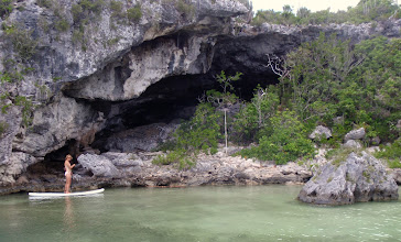 Photo: Anne paddling alongside a cave at Little Harbor