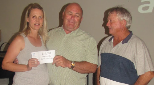 Rachel Cruckshank of Namoi Cotton hands over a cheque for $10,000 to Yarrie Lake Bore Working Group members Lester Kelly and Fred Browning.