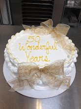 Photo: Classic Lisa's Rum Cake border with Gold French ribbon bows & gold writing.