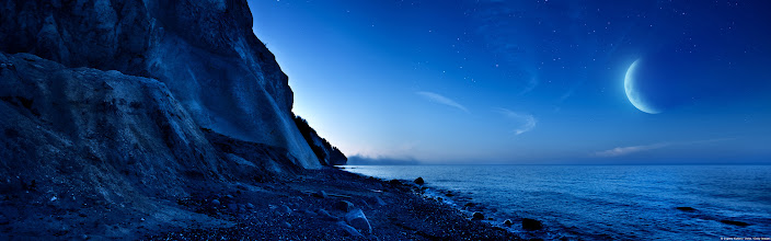 Photo: Night shot of mountains and sea, Denmark