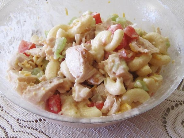 In a large bowl, gently mix the chicken with the macaroni salad. Fold in...