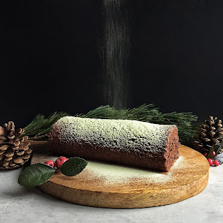 Chocolate Roulade with Fudge & Matcha Icing Sugar.
