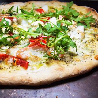 Seafood Pizza with basil sauce.