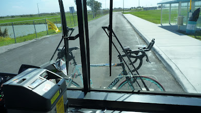 Photo: Here the bike rides on a rack in front of the bus