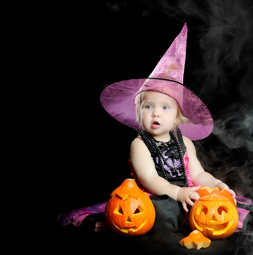 Halloween baby witch with a carved pumpkin over black background with smoke by Ira Ivanova - Public Holidays Halloween ( person, seasonal, mystery, holding, hat, halloween, kid, sorcery, mystical, autumn, witch, childhood, cheerful, fairytale, spell, black, scary, pumpkin, fun, smoke, holiday, charming, magic, evil, cap, cute, pretty, fantasy, child, girl, attractive, pwcpumpkins, baby, celebrate, hair, carnival, spooky, beautiful, witchcraft, sorcerer, traditional, young, wicked, female, emotional, elegant, background, costume, october, horror, fear )