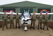 The Kruger National Park's anti-poaching unit with the brand new FOXBAT A22LS aircraft - a donation from the MyPlanet Rhino Fund.