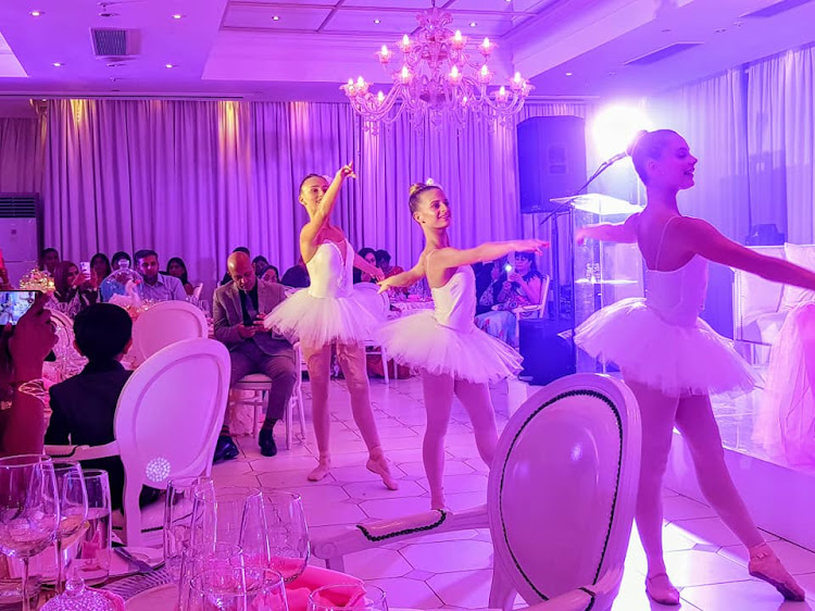 Ballerinas added to the Swan Lake theme of the celebration at the Oyster Box Hotel.
