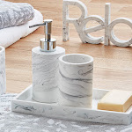 Image of towels, marble effect bathroom accessories and a sign saying 'Relax'