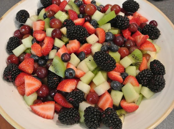 While baking mix the sugar and Amaretto and pour over the prepared fruit and...