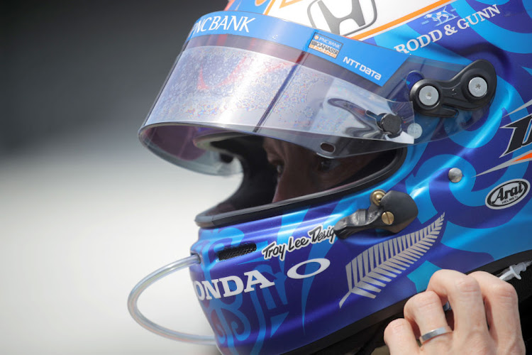 Scott Dixon, driver of the #9 PNC Bank Chip Ganassi Racing Honda, looks on prior to practice for the NTT IndyCar Series GMR Grand Prix at Indianapolis Motor Speedway on July 03, 2020 in Indianapolis, Indiana.