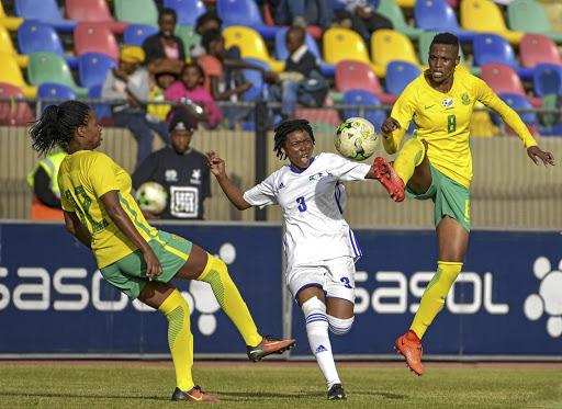 Jermaine Seoposenwe of Banyana, left, gets her foot in as teammate Kgaelebane Mohlakoana, right, towers above Tsoanelo Leboka of Lesotho during their qualifier yesterday.