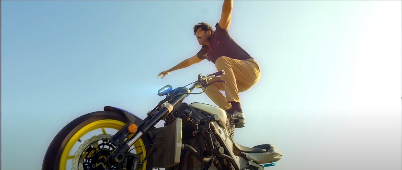 Fahad Mustufa on bike performing stunt.