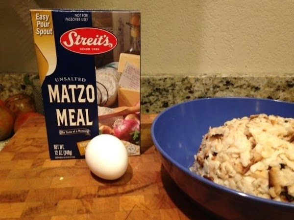 Mix the matzo with the egg, oil, and enough matzo meal to make it...