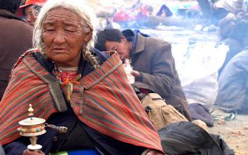 Photo: Beautiful older Tibetan woman at Tarboche on Saga Dawa day, spinning her prayer wheel
