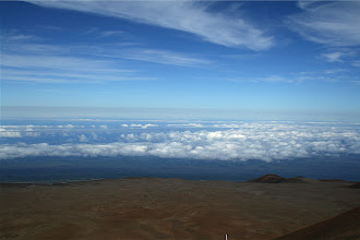 """Photo: Volcanic fog (""""vog"""") layer to the east of Mauna Kea, beneath cirrus clouds and above the thermal inversion-capped convective clouds.  The vog is not so white as the water clouds because of sulphur in the droplets.  The inversion at the time of this picture was at 6000ft.  The photo was taken from 14000ft."""