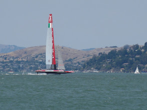 "Photo: Luna Rossa on ""three legs"", the preferred mode for maximum speed of up to 40 kn (75 km/h), with the leeward wing and both rudders with their smaller wings in the water. Speed with the hull in the water is 20 kn and acceleration back to 40 kn is reached within 10 seconds!"