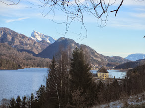 Photo: fuschlsee with castle fuschl + the snowy schafberg hill (1782 m) behind