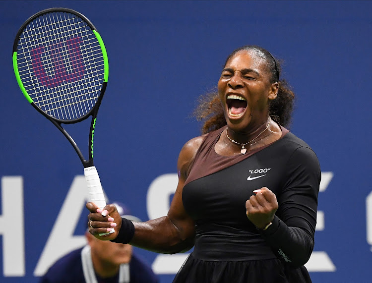 Serena Williams of the USA celebrates a winner against Magda Linette of Poland in a first round match on day one of the 2018 US Open tennis tournament at USTA Billie Jean King National Tennis Center on August 27, 2018 in New York.