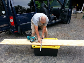 Photo: Terry W8ZN prepares additional shelf for N3UW rover used by K8GP rover in ARRL June VHF 2014