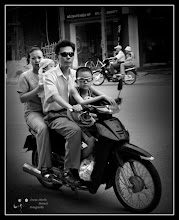 Photo: 2 Motorcycles 8 people I was photographing in Vietnam the bike that was closest to me, to see who had 4 occupants. Only after taking the picture I saw I had caught another motorcycle on the same terms in the background. My contribution to: #transporttuesday  +TransportTuesdayby +Gene Bowker+Joe Paul+Steve Boyko+Michael Earley #breakfastclub by +Gemma Costa #breakfastartclub by +Kate Church #plusphotoextract by +Jarek Klimek