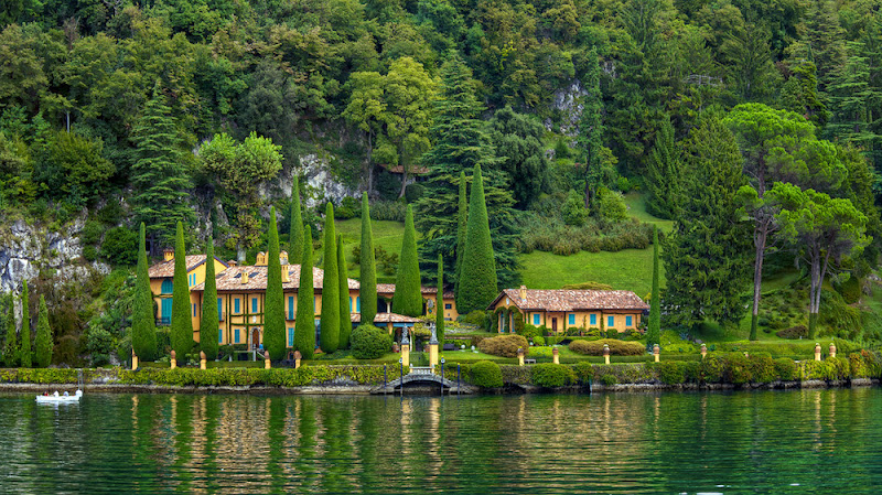 Photo: Storybook Land in Real Life - Lake Como Villa, Italy  Famed Lake Como (north of Milan in Italy) boasts amazing villas like this along its fingered shoreline. We felt like we were on the Storybook Land canal boat ride at Disneyland as we passed many luxurious Italian villas on our way to the town of Bellagio. Yes, we did see the well-known villa that belongs to George Clooney, but it didn't look as impressive from Lake Como as this one.