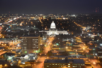 Photo: Had a photographic event the other night that took me up a downtown building. That's the Arkansas State Capitol... where I spend my days.