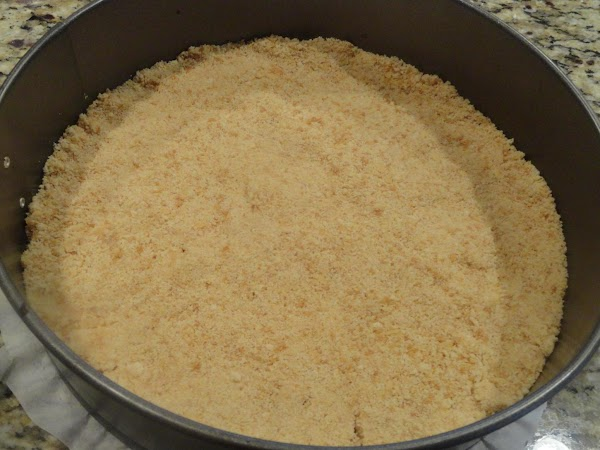 For the crust, in medium bowl, combine first 4 ingredients and press into the...