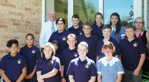 Some of the Narrabri High School Year 7 students who had their first day of secondary education yesterday (and modelling the new school uniforms), with principal Rod Jones and Year 7 adviser Cherrie Pocock - back, Kaleb Teer (formerly Narrabri Public School), Addison Russell (Narrabri West Public School), Montana Olding (NWPS), third row, Charlie North (NPS) Jacob Coxon (NPS), Lachlan Large (NPS), Matthew Penberthy (NPS), second row, Jemma Harvey (NWPS), Riley Longworth (partially obscured, NWPS), Jim Dent (NWPS), front, Juwan Tovehi (NWPS), Charlee Croaker (NWPS), Joshua Taylor (NPS), Eliza Weissen (NPS).