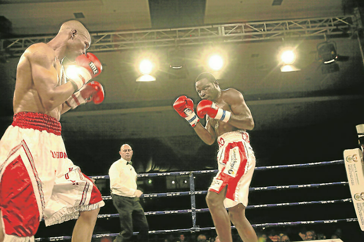 Underdog Tsiko Mulovhedzi, right, of Limpopo took the IBO welterweight crown from Mdantsane's Ali Funeka in East London last Friday.