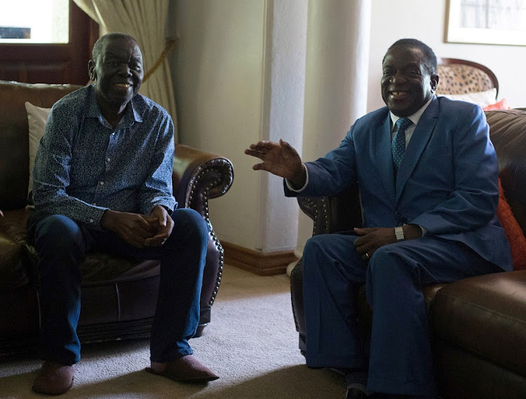 Zimbabwean President Emmerson Mnangagwa (R) chats during his visit to opposition leader Morgan Tsvangirai at his house in Harare on January 5, 2018. Picture: REUTERS/PHILIMON BULAWAYO