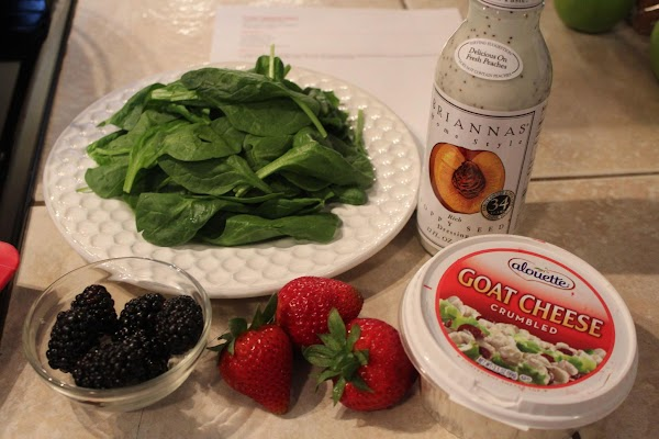 Chop the fresh spinach. Top with cut or sliced strawberries. Add the blackberries and...