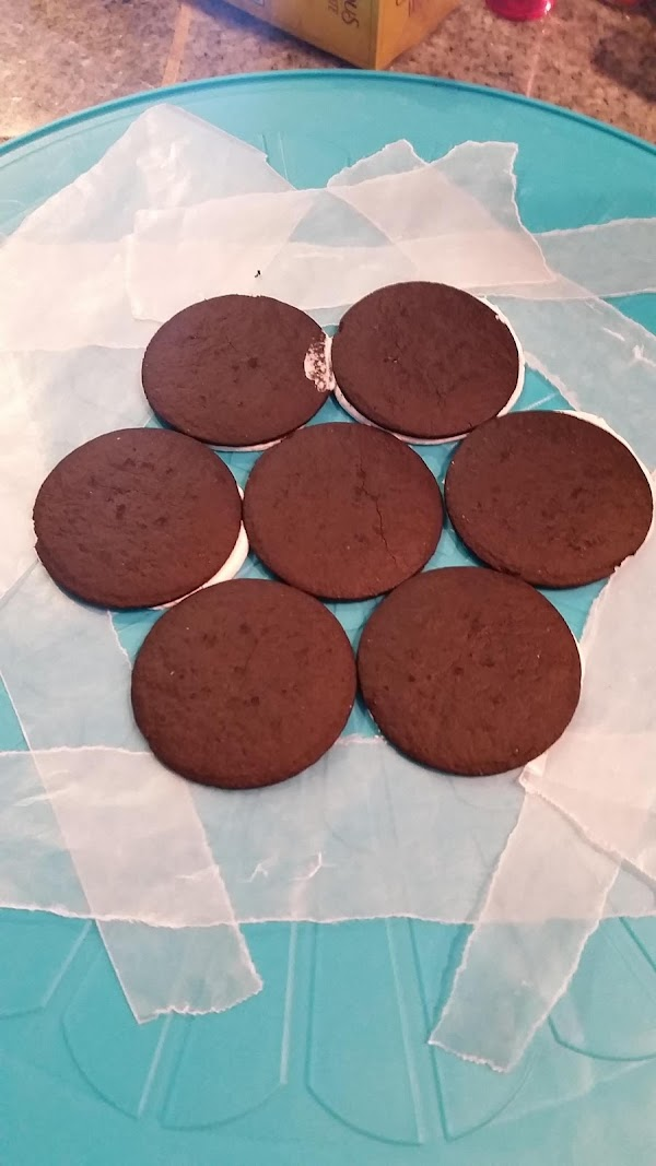 Use a cake stand or a plate and arrange a layer of chocolate wafers...