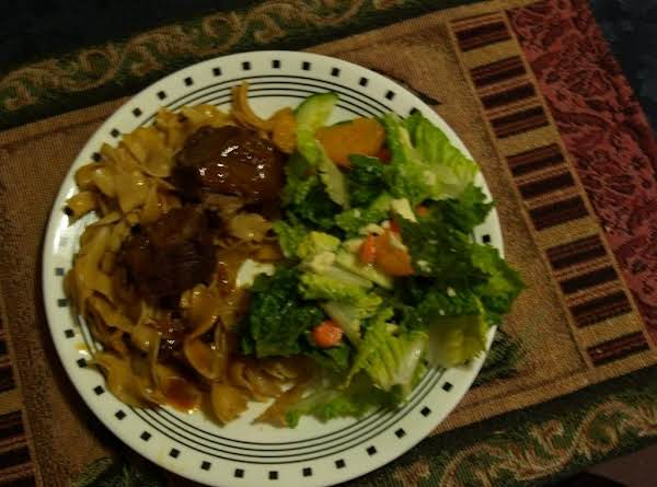 Bavarian Pot Roast Over Noodles On The Left, Super Salad On The Right.