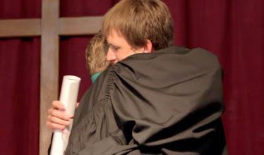 Photo: Having received his call papers, seminarian Javier Kinas embraces seminary Director Rev. Sergio Fritzler.