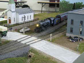 Photo: S Helper Service Consolidation brings a passenger train past the Cannery and Church