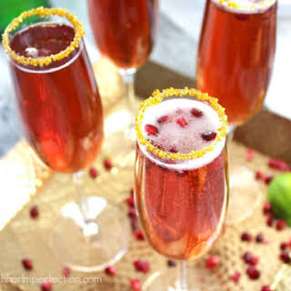 Pomegranate Ginger Champagne (or Mocktail) w/Gold Sugared Rim.