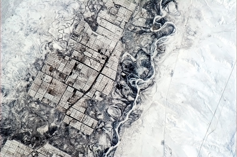 Photo: Humans need straight lines, nature doesn't. Indecisive river and orderly farmers, central Asia.
