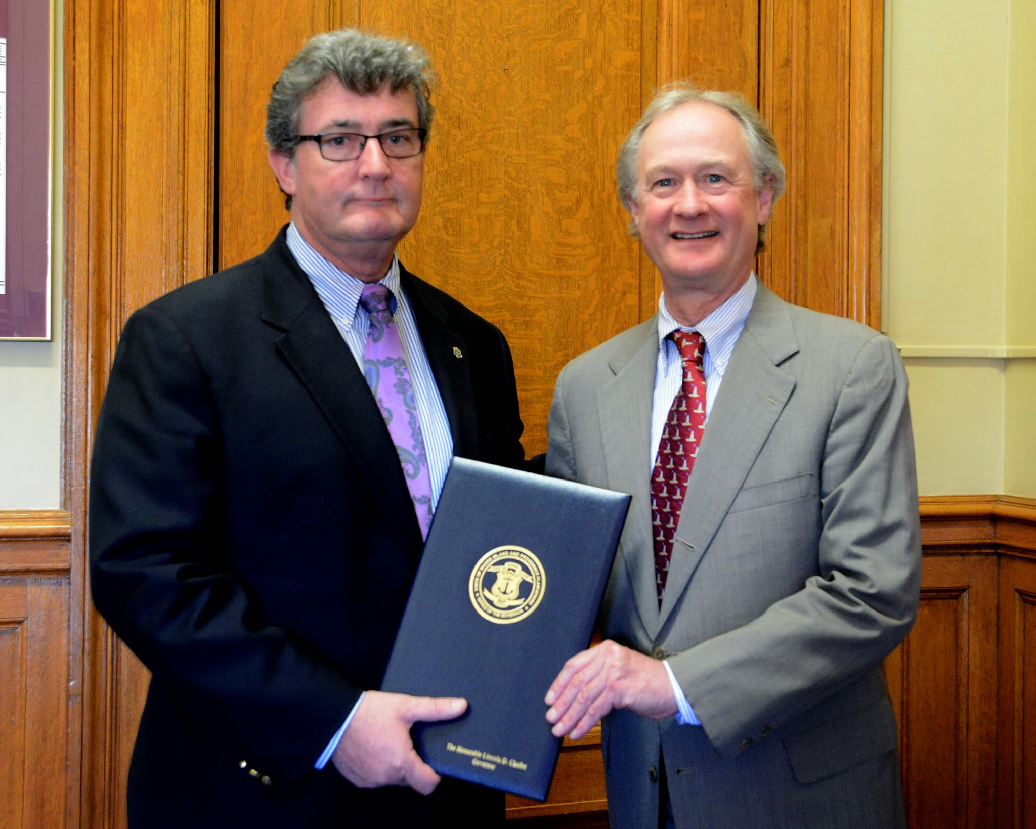 Photo: Rep. Robert Craven is presented a ceremonial copy of his legislation by Governor Lincoln Chafee that he signed on May 6, 2014.  Rep. Craven's legislation saved a $6 million federal grant awarded to the Quonset Development Corporation by the federal government.