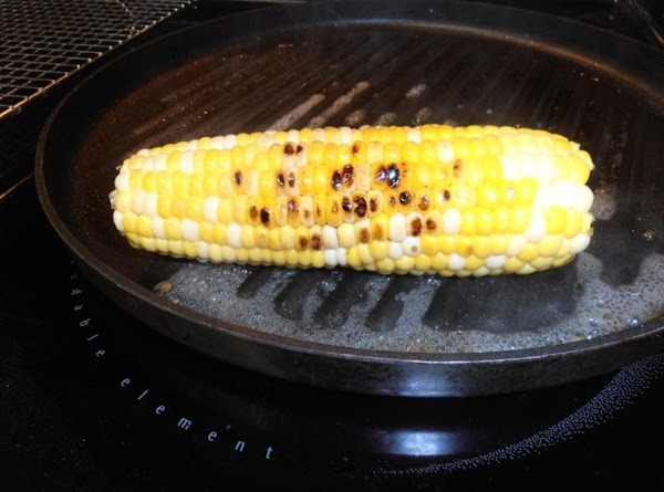 in a hot oiled skillet, grill corn for 5-6 minues. cut off cobb
