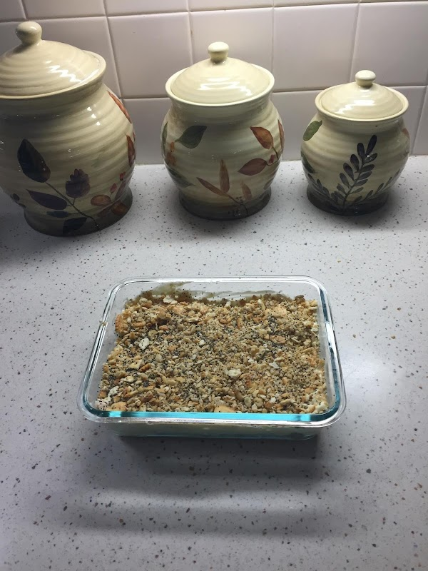 Mix together the cracker crumbs, melted butter and poppy seed in a bowl. Layer...