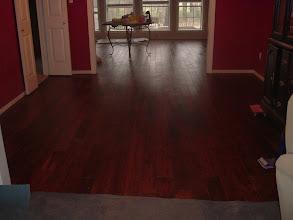 "Photo: hand scraped 4"" planks installation large room"
