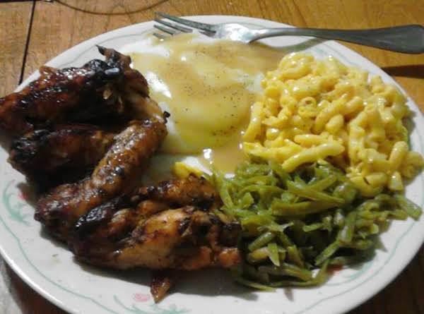 Those Are The Honey Baked Wings With Mashed Potato's And Chicken Gravy, Mac And Cheese, And String Beans.