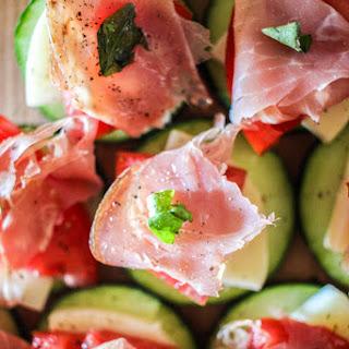 Mozzarella, Prosciutto, and Tomato Basil Cucumber Bites.