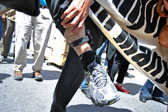 Photo: Mohammad Mahjoub shows the media the GPS device that he has been ordered by the Canadian Security and Intelligence Services (CSIS) to wear on his ankle 24/7.