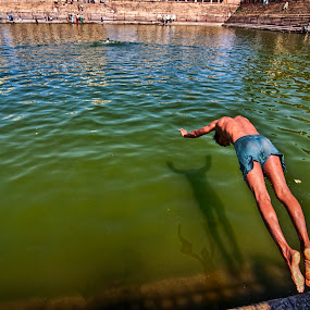 Respite from heat by Rajarshi Chowdhury - People Street & Candids ( water, green water, pool, sports, heat, kid, jump )