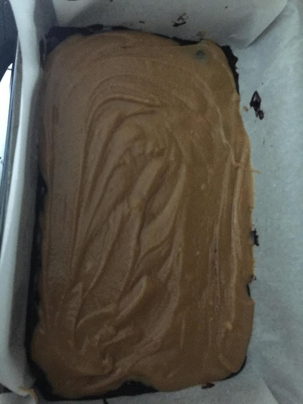 Place  half of the brownie batter on the bottom of the baking pan...
